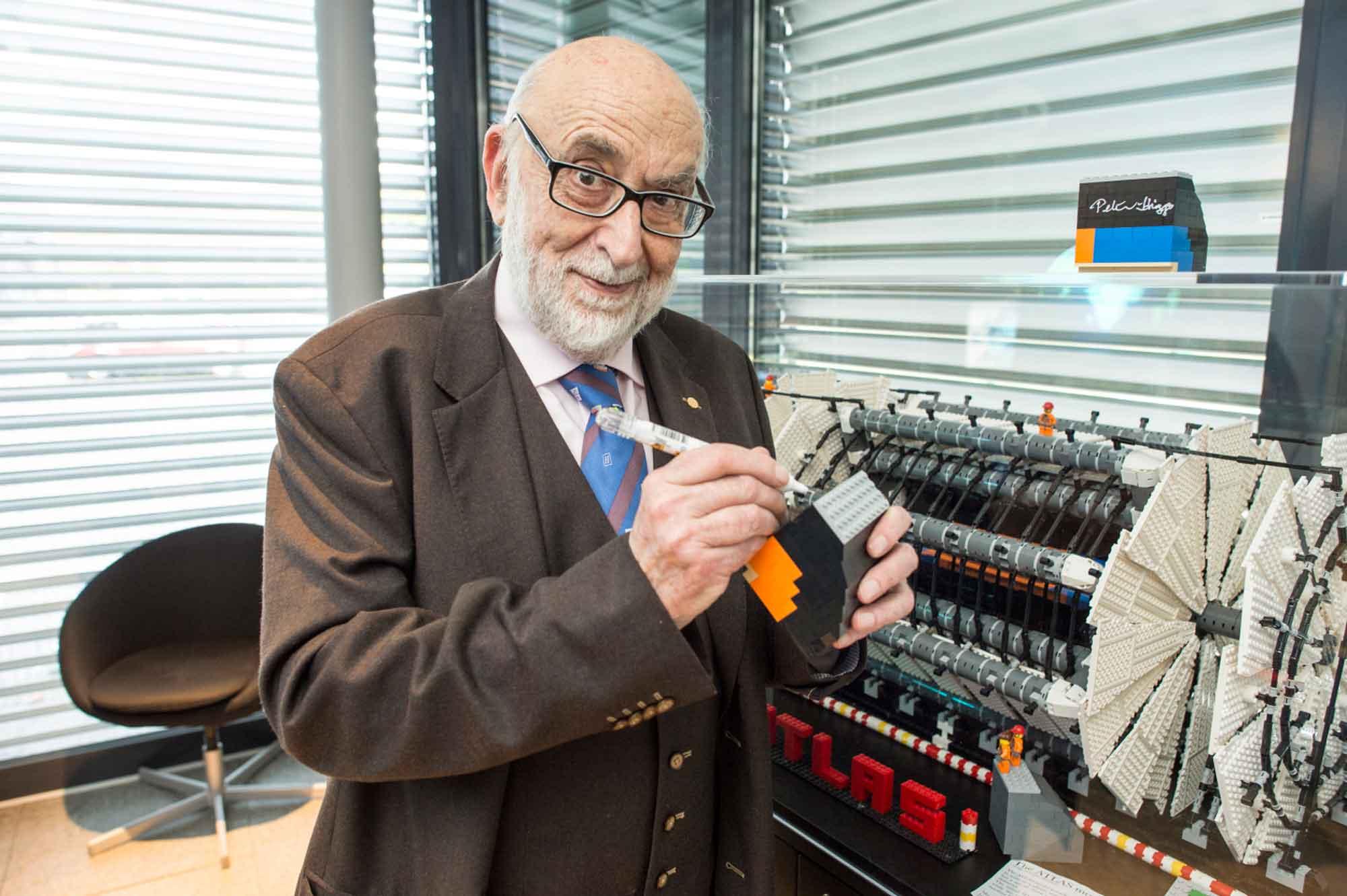 François Englert signs a LEGO model of the ATLAS detector
