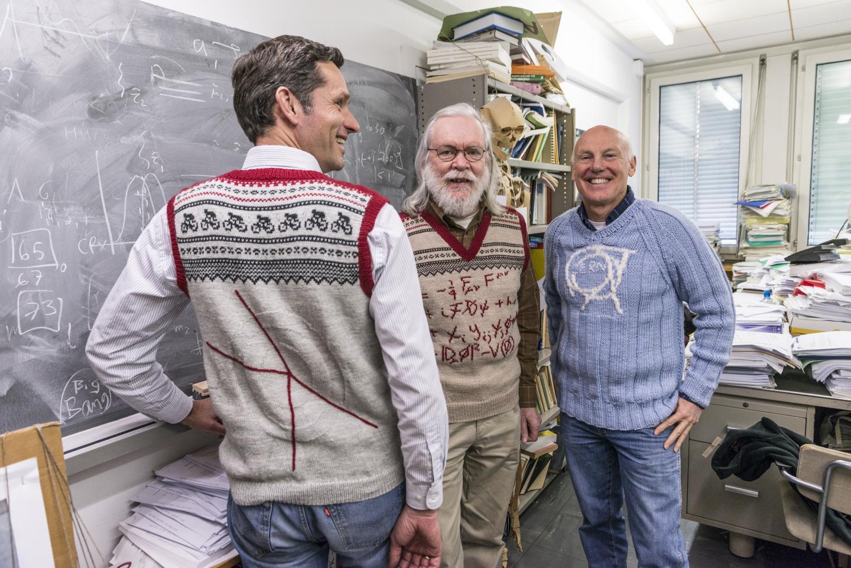 CERN's Jens Vigen, John Ellis and Mick wearing hand-knitted sweaters